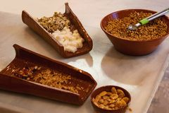 Various types of sweets made from nuts, white and brown nougat in brown bowls which have just been prepared fresh in nougat stock images