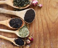 Various types of tea. In a wooden spoon stock photography