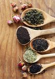 Various types of tea. In a wooden spoon stock photos