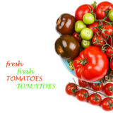 Various types of tomatoes in a bowl on the table Stock Photos