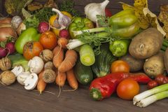 Various types of vegetables on an old wooden table. The concept of diet food. Food for obese patients. Stock Photo