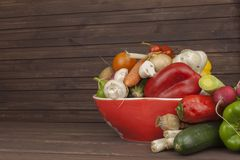 Various types of vegetables on an old wooden table. The concept of diet food. Food for obese patients. Stock Images