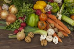 Various types of vegetables on an old wooden table. The concept of diet food. Food for obese patients. Stock Photos