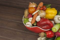 Various types of vegetables on an old wooden table. The concept of diet food. Food for obese patients. Stock Image