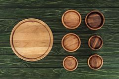 Various types of wooden round cutting boards. On table royalty free stock photo