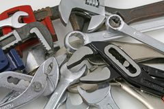 Wrenches. Various types of wrenches laying on a white surface Stock Images