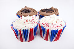 Various Union Jack cupcakes against white background Royalty Free Stock Photo