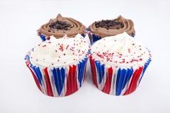 Various Union Jack cupcakes against white background Royalty Free Stock Photo