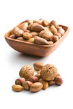 Various unpeeled nuts in wooden bowl Stock Photography