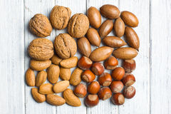Various unpeeled nuts Stock Images