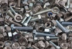 Various, various bolts, nuts, screws and washers lying all together in a heap, top view.  royalty free stock photography