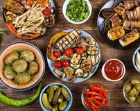 Various vegan dishes and snacks. Grilled vegetables. Barbecue, picnic. Concept: vegetarianism eating outdoors Royalty Free Stock Images
