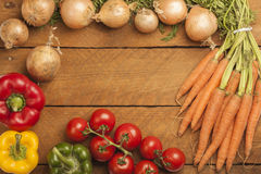 Various Vegetables As Frame On Wood Stock Image