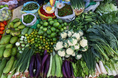 Various vegetables on the Asian food market. With cauliflower, cucumbers, eggplants, chili, and bok choi Royalty Free Stock Photography
