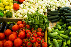 Various vegetables in boxes at market. Tomatoes, basil, onions, courgettes and peppers Stock Photography