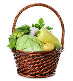 Various vegetables in a brown basket Royalty Free Stock Photos