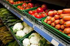Various vegetables on display in grocery store Royalty Free Stock Images