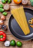 Various vegetables fruits and herbs with a frying pan Royalty Free Stock Image