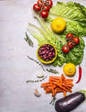 Various vegetables and fruits, laid out vertically, Ingredients for cooking vegetarian food, border, place for text on wooden rust Stock Photography