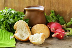 Various vegetables and herbs, bread and milk Royalty Free Stock Image