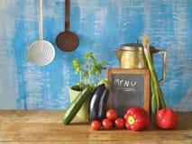 Various vegetables, menu black board, kitchen utensils,free copy Royalty Free Stock Photo