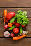 Various vegetables for a salad (cucumbers, tomatoes, lettuce, radishes, carrots) Royalty Free Stock Photo