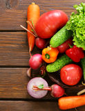 Various vegetables for a salad (cucumbers, tomatoes, lettuce, radishes, carrots) Royalty Free Stock Photography