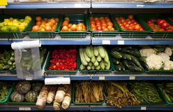 Various vegetables on shelves in grocery store Royalty Free Stock Photo