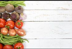 Various vegetables on the table, beets, tomatoes, onions, garlic Royalty Free Stock Photography