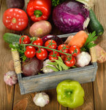 Various vegetables in a wooden box Royalty Free Stock Images