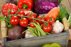 Various vegetables in a wooden box Royalty Free Stock Image