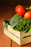 Various vegetables in a wooden box Stock Image