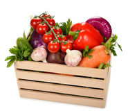 Various vegetables in a wooden box Royalty Free Stock Photo