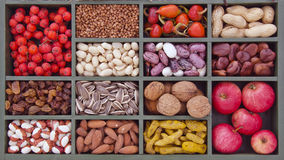 Various Vegetarian Healthy Fruits And Seeds In Wooden Box Stock Photo