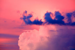 Various vibrant pink blue and white sunset clouds Stock Image