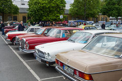 Various vintage cars standing in a row. Royalty Free Stock Photography