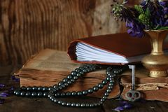 Arab book and flower Stock Images