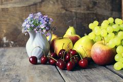 Fresh raw fruit on wooden background. Various vintage elements on old worn backgrounds different concepts Stock Image