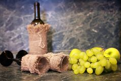 Table with wine bottle grape stock photo