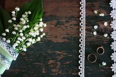Wedding bouquet of lilies of the valley and rings. Various vintage elements on old worn backgrounds different concepts Royalty Free Stock Photo