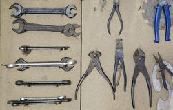 Various vintage old metal tools. Tools on wooden board in workshop Stock Image