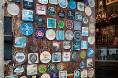 Various Vintage Table Coasters Inside Pub Arezzo Stock Image