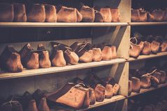 Various of vintage wooden shoe lasts in a row on the shelves. Stock Images