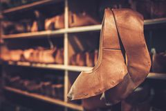 Various of vintage wooden shoe lasts in a row on the shelves. Royalty Free Stock Image