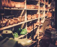 Various of vintage wooden shoe lasts in a row on the shelves. Stock Photography