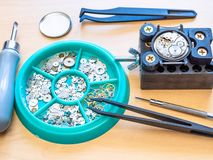 Various watch repairing tools and spare parts royalty free stock photography