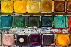 Various watercolor pigments in the color-saucer Royalty Free Stock Photos