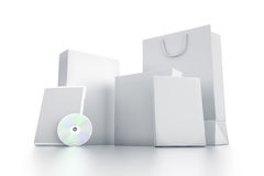 Various white boxes and DVDs. Stock Photos