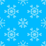 Various white crochet snowflakes on blue background. Royalty Free Stock Image
