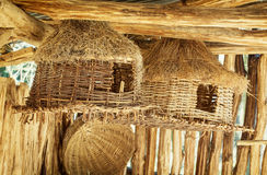 Various wicker bird houses and baskets Stock Photo